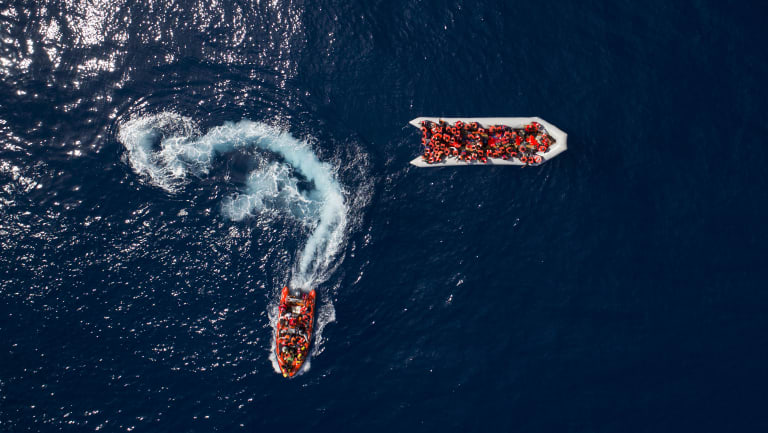 Refugees and migrants are rescued by members of the Spanish NGO Proactiva Open Arms, after leaving Libya trying to reach European soil aboard an overcrowded rubber boat last month.