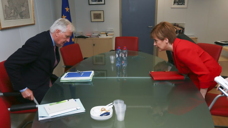 The EU chief Brexit negotiator Michel Barnier, left, and Scottish First Minister Nicola Sturgeon prepare for a meeting at EU headquarters in Brussels, last year.
