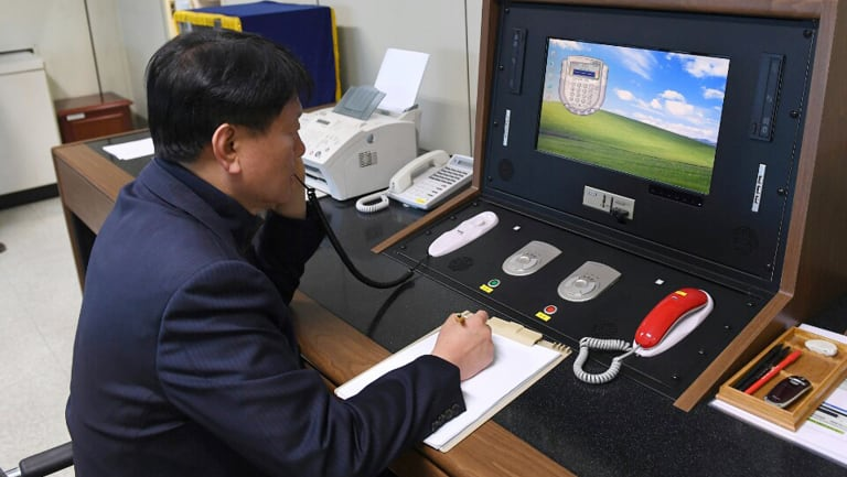 A South Korean government official communicates with a North Korean officer during a phone call on the dedicated communications hotline at the border village of Panmunjom.