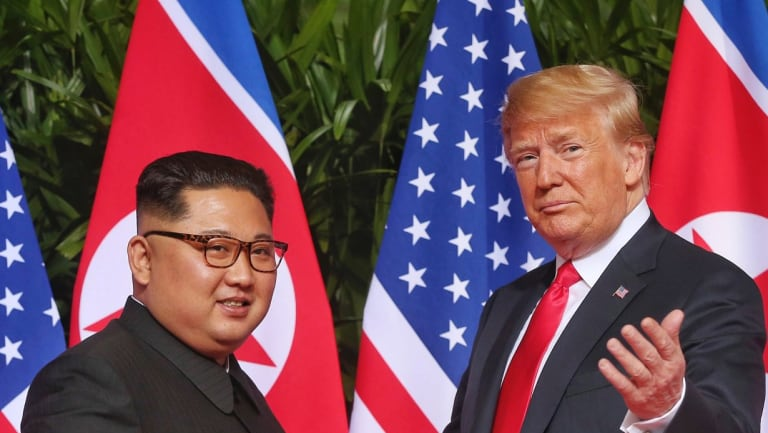 US President Donald Trump gestures toward the media with North Korea leader Kim Jong-un.