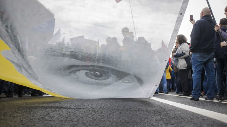 Protesters hold a poster depicting Oleg Sentsov during an opposition rally organised by  'Free Russia' in Moscow.