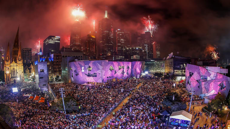 The midnight fireworks display, seen from Federation Square, lights up the city skyline during last year's New Year's Eve celebrations.