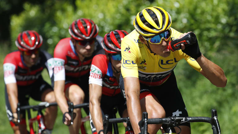 Belgium's Greg van Avermaet dons the yellow jersey during stage five.