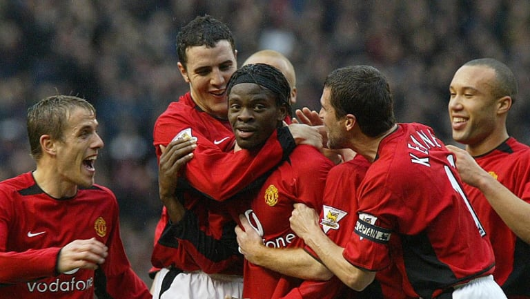 Louis Saha, center, is congratulated after scoring his first goal for Manchester United against Southampton in 2004.