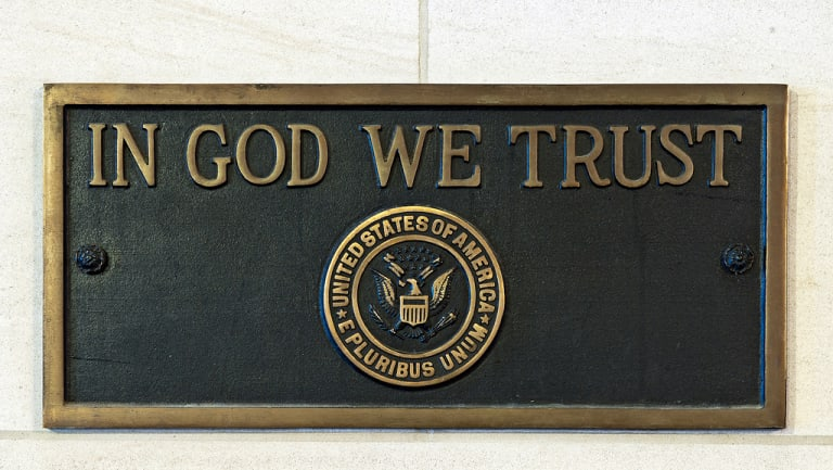 The US motto on a plaque at the US Capitol building. Louisiana will require public schools to display the motto by August 2019. Florida passed the same bill in February.