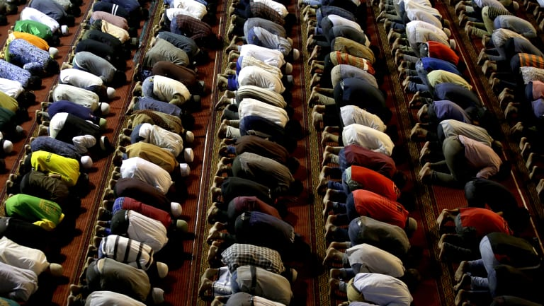 Muslims in Indonesia perform an afternoon prayer during Ramadan.