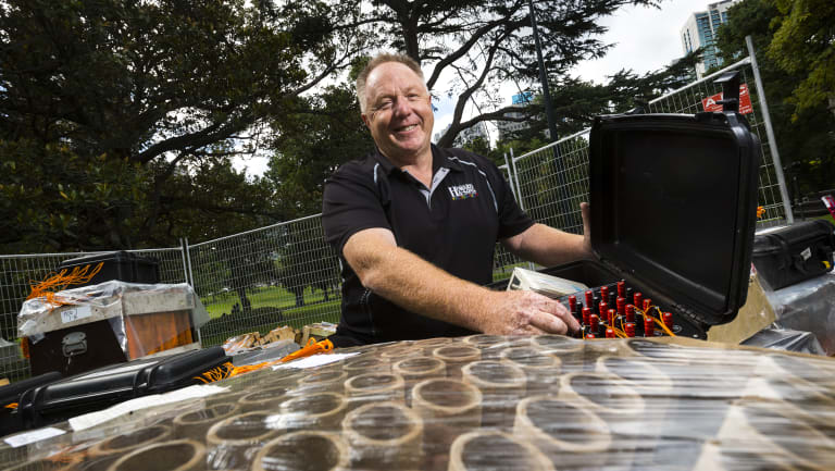 Rusty Johnson in Flagstaff Gardens with some of the fireworks that will be used in Melbourne's New Years Eve pyrotechnic display.