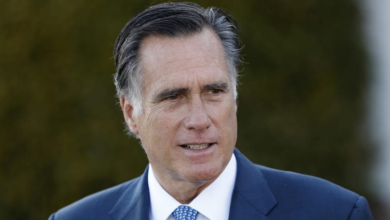 Mitt Romney talks to media after meeting with President-elect Donald Trump in November 2016.