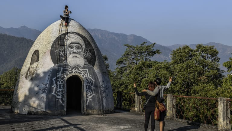 Visitors at a meditation pod on the roof of the ashram formerly run by Maharishi Mahesh Yogi, where members of the legendary band The Beatles famously stayed in 1968, in Rishikesh, India.