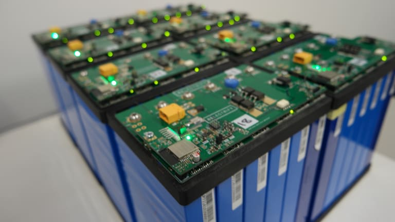 Former electric vehicle batteries are combined to create a single household battery storage unit.