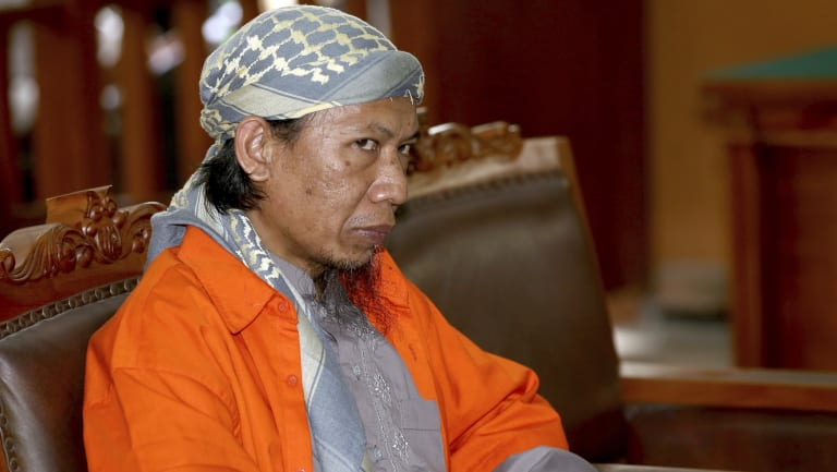 Indonesian militant Oman Rohman, popularly known as Aman Abdurrahman, sits on the defendant's chair during his trial.
