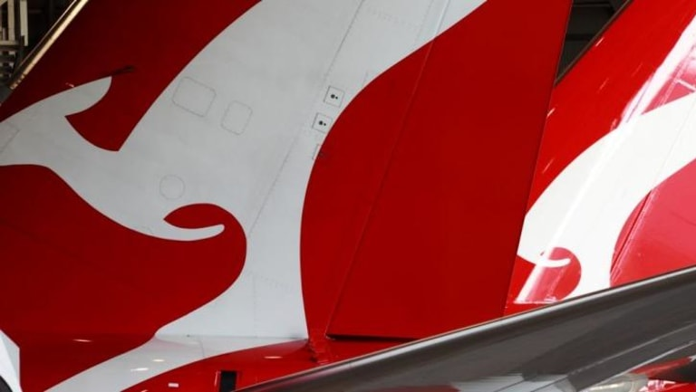 Qantas has reported a record high half-year profit.