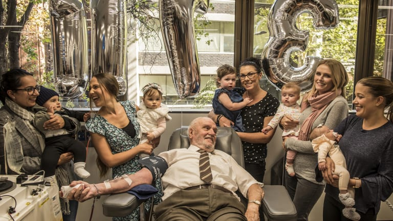 James Harrison (centre), surrounded by mothers of Anti-D babies at his final donation.  L-R: Christine Damiandis and Georgio, Michelle Dibbs and Eloise, Tanya McLaren and Brianna, Sarah Doyle and Grace