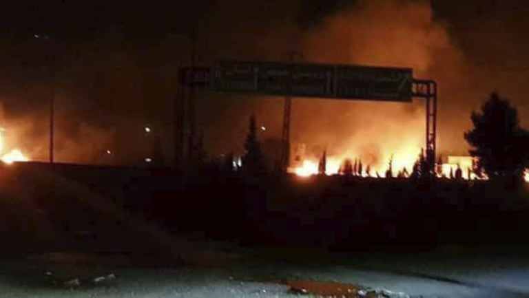 Flames rising after an attack in an area known to have numerous Syrian army military bases, in Kisweh, south of Damascus, Syria. Syrian state-run media said Israel struck a military outpost.
