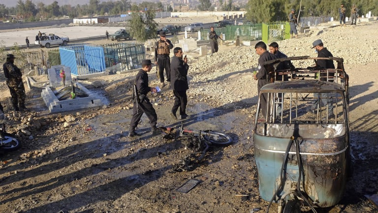 Afghan security forces inspect the site of a deadly bombing in Jalalabad province, east of Kabul, Afghanistan, on Sunday.