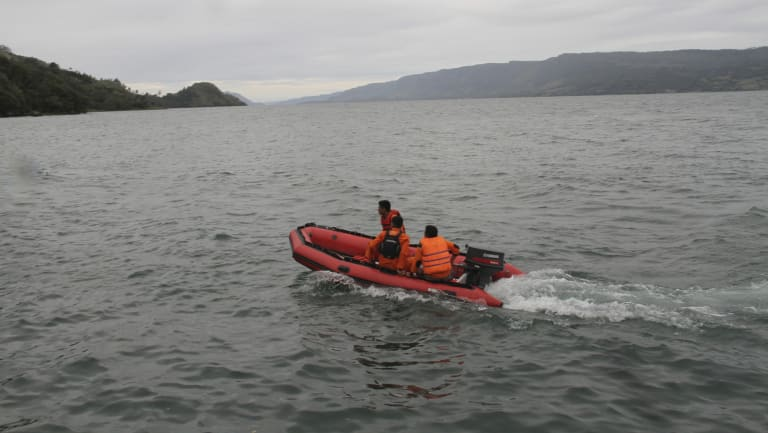 An Indonesian search and rescue team searches for survivors.