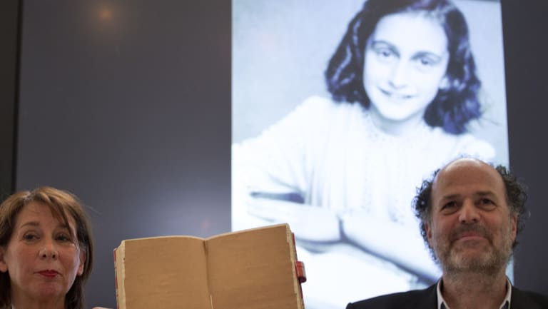 Teresien da Silva, left, and Ronald Leopold of the Anne Frank Foundation show a facsimile of Anne Frank's diary with two pages taped off during a press conference at the foundation's office in Amsterdam, Netherlands.