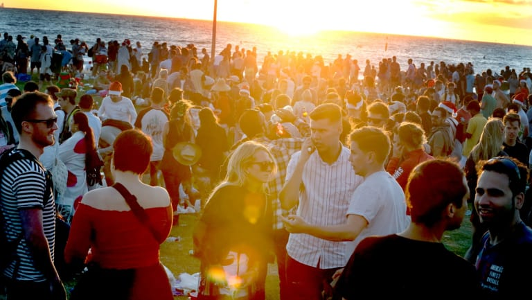 Thousands of people booze on St Kilda Beach on Christmas Day before police were called to intervene.