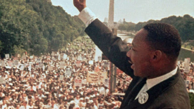 "Dr Martin Luther King jnr acknowledges the crowd at the Lincoln Memorial for his ""I Have a Dream"" speech  in 1963."
