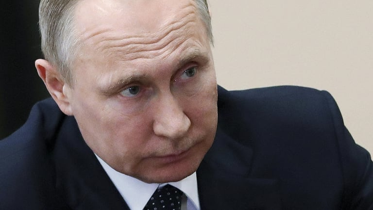 Russian President Vladimir Putin's government is accused of waging cyber war after Syrian strikes.