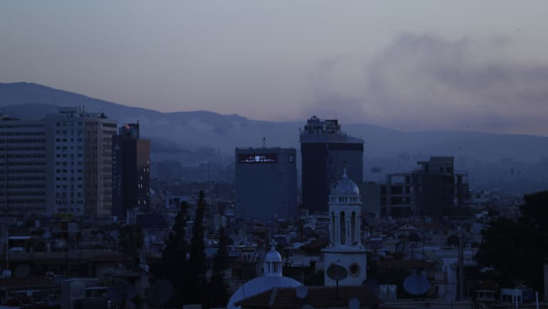 Smoke rises after air strikes targeting different parts of the Syrian capital Damascus early on Saturday.