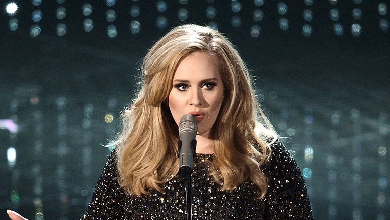 Superstar Adele has joined survivors of the Grenfell Tower fire for an emotional tribute.