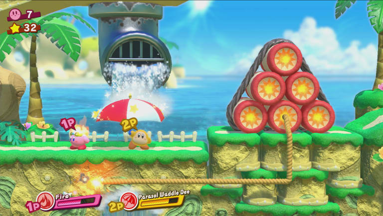 A friendly Waddle Dee helps Fire Kirby light a fuse.