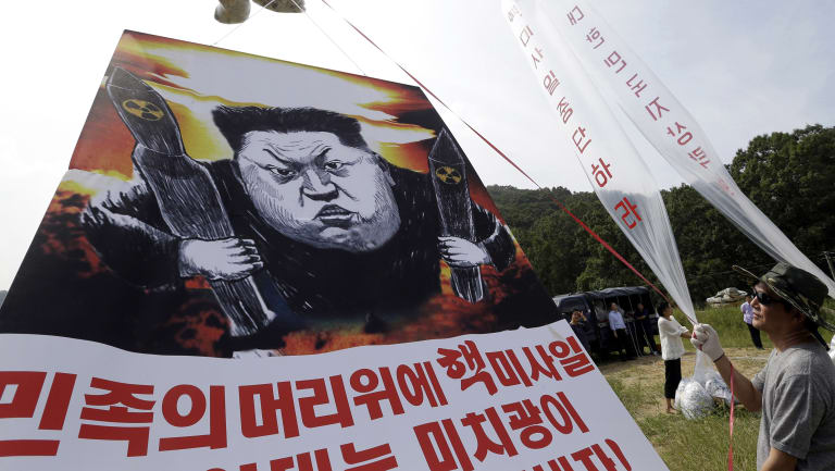 North Korean defectors prepare to release balloons carrying leaflets and a banner denouncing North Korea's latest nuclear test.