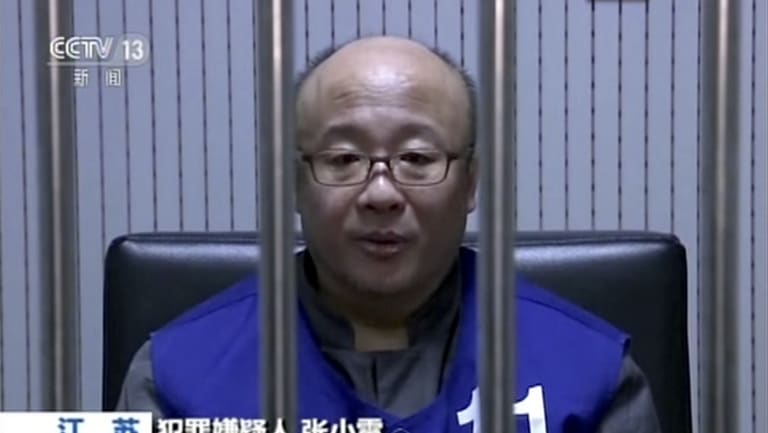 Qianbao founder Zhang Xiaolei speaks with police while in custody in Nanjing in eastern China's Jiangsu province.