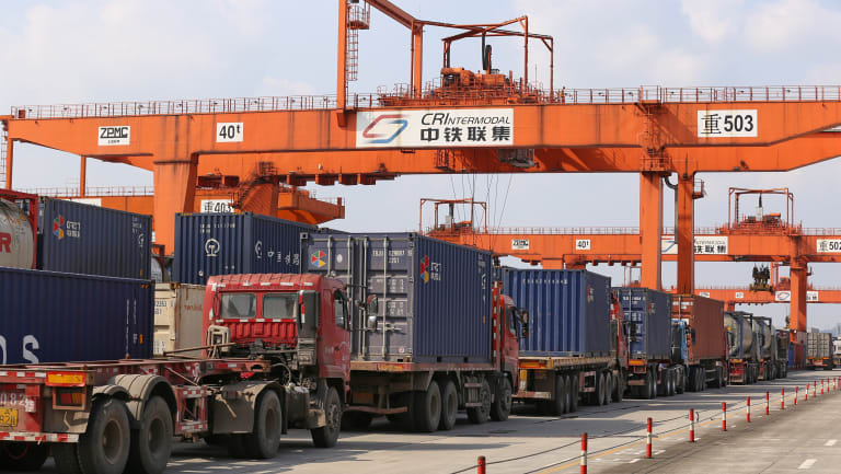 Trucks lined up to load containers at Chongqing Western Logistics Park .