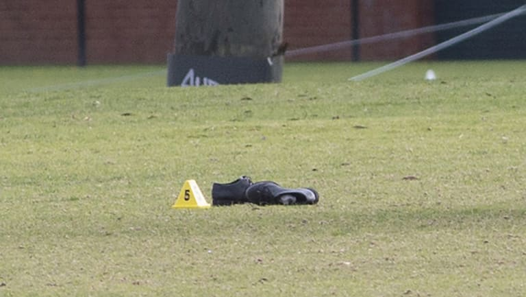 A pair of men's lace-up shoes at the crime scene.