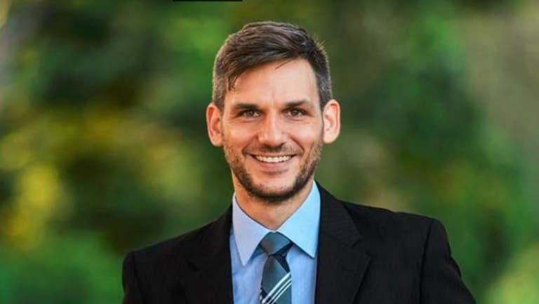 Greens candidate for Maiwar Michael Berkman has claimed victory in the Queensland Parliament.