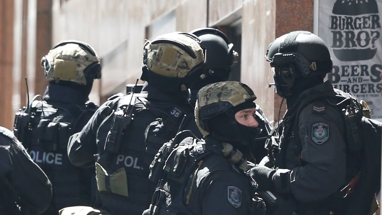 Tactical police assemble a block away from the siege in Sydney's Martin Place.