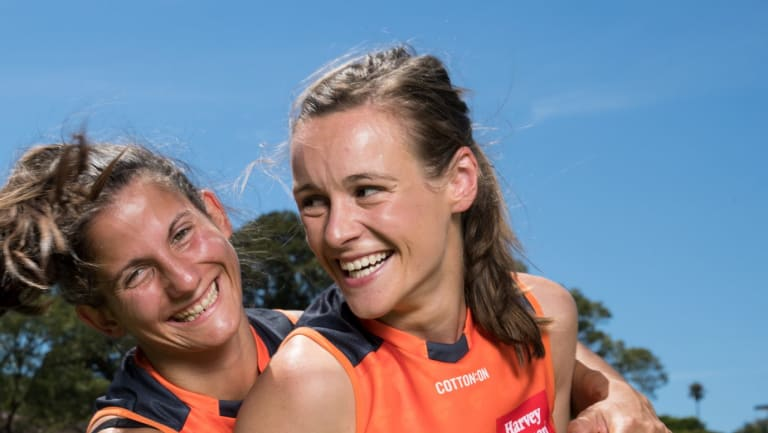 Happy times: Alicia Eva (right) with Giants teammate Jessica Dal Pos.