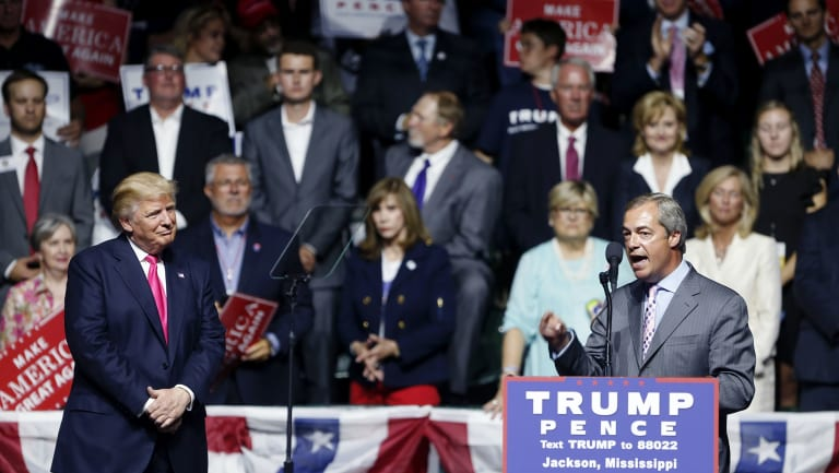 Nigel Farage, ex-leader of the British UKIP party, speaks as Republican presidential candidate Donald Trump, left, listens, at Trump's campaign rally in Jackson, Mississippi in 2016.