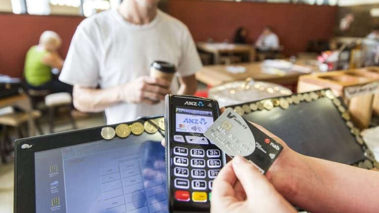 Banks are committing to giving retailers the option of cheaper tap-and-go debit payments.