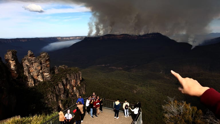 Tourists at Echo Point, Katoomba, get more than they bargained for during visits to the Blue Mountains.