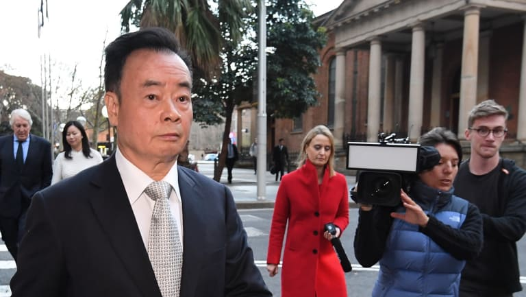 Chau Chak Wing leaves the Federal Court.