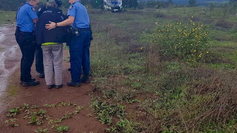 The woman was assessed by searchers before she was evacuated.