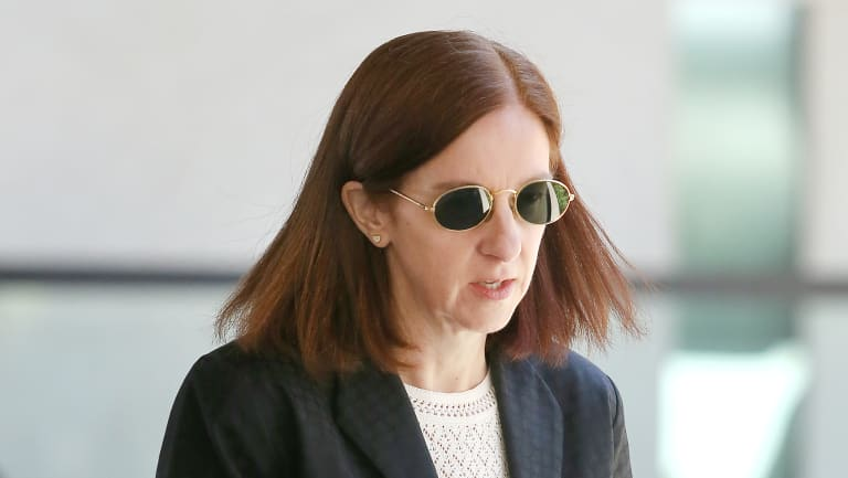 Suzanne Miller leaves the Magistrates court in Brisbane on Wednesday.