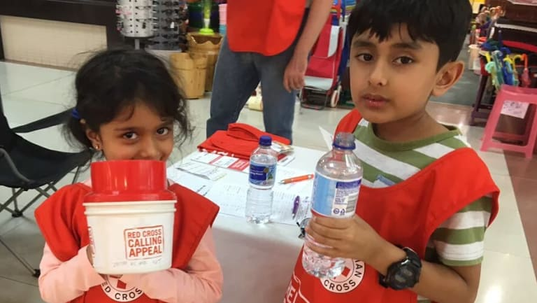 Children from the  Ahmadiyya Muslim community raising funds for the Red Cross in 2017.