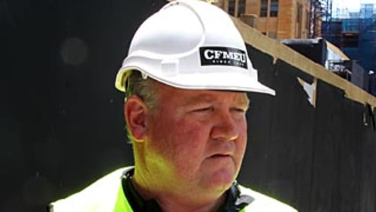 Former CFMEU state secretary Brian Parker wearing a sticker banned under the Commonwealth building code