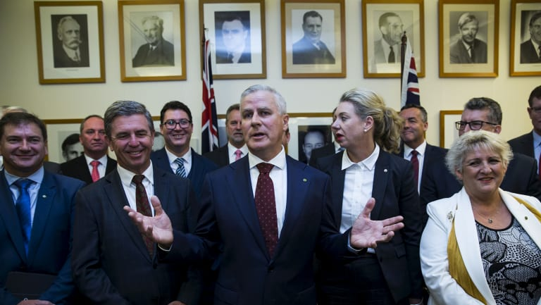 The new leader of the National Party, Michael McCormack, flanked by Nationals MPs following a leadership ballot on Monday.