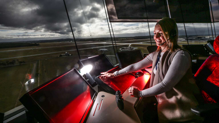 Kristen Roe , enroute air traffic controller, behind the console at Tullamarine tower.