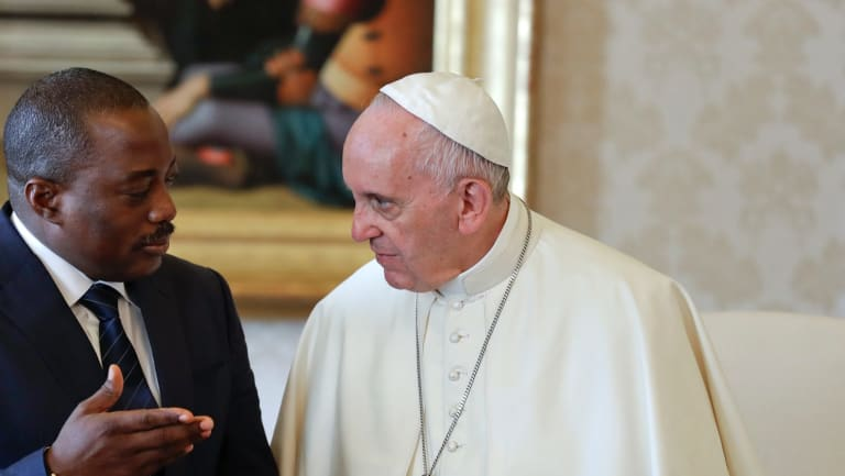 Pope Francis talks with Congo President Joseph Kabila in 2016.