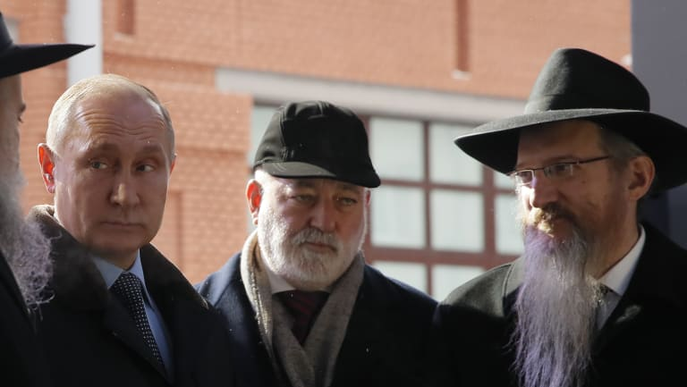 Russian President Vladimir Putin and, businessmen Viktor Vekselberg, second from right,  stand next the stone of the memorial to members of the resistance at Nazis concentration camps during WW II, at the Jewish Museum and Center for Tolerance in Moscow, Russia in January.