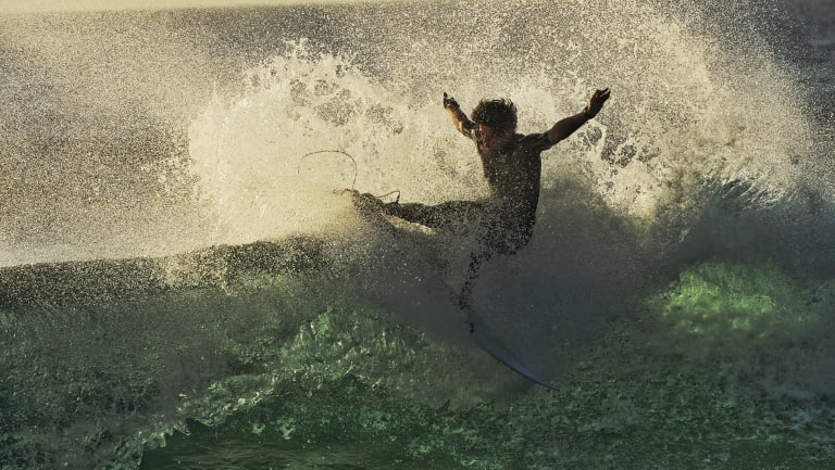 Surfers at North Narrabeen on Friday take advantage of the start of several days of massive swells along the NSW and Queensland coasts.