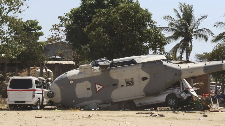 The helicopter crashed onto several vehicles packed with survivors.