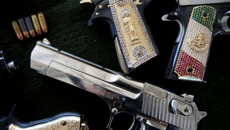 Guns seized from Mexican drug cartels by the military. Martin Woods helped expose money laundering by cartels through one of the US's biggest banks.