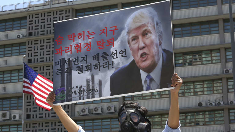 A South Korean environmental activist protests against the US withdrawal from the Paris climate accord last year.